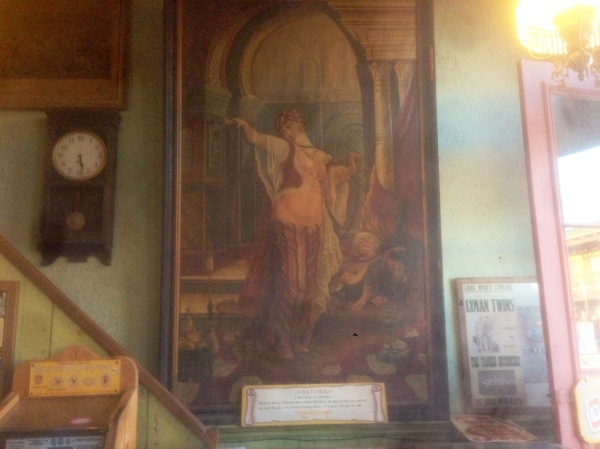 The original paining of Fatima, hanging in the lobby of the Birdcage Theater