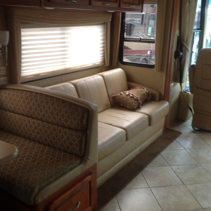 Couch # 2 and Dinette. I think some of the upholstery in this unit needs replacement.